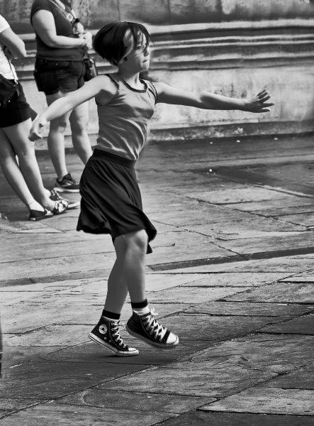 GIRL DANCING WHILE WAITING FOR MOTHER OXFORD UK - Joe Finkleman